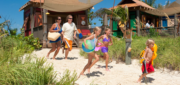 Family enjoying time together at the beach on Castaway Cay.