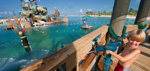 Boy enjoying the Pelican Plunge water feature at Castaway Cay.