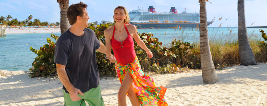 Couple walking on the beach at Disney's Castaway Cay