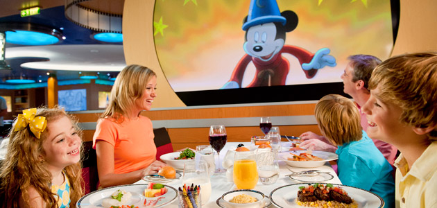 Family dining at Animator's Palate onboard Disney Dream.