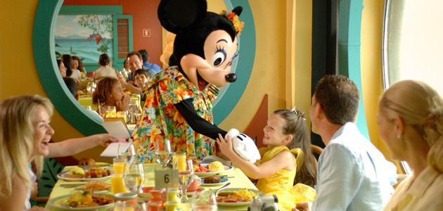 Guests dining at Parrot Cay onboard Disney Magic.