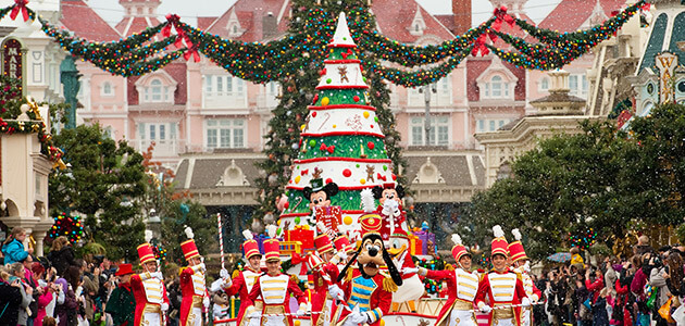 christmas parade with disney characters on main street usa - Disneyland Christmas Decorations