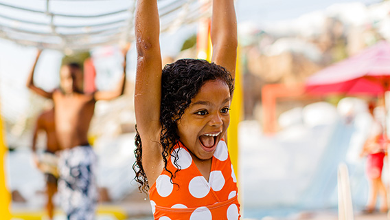 Young guest splashing around at Disney's Blizzard Beach Water Park