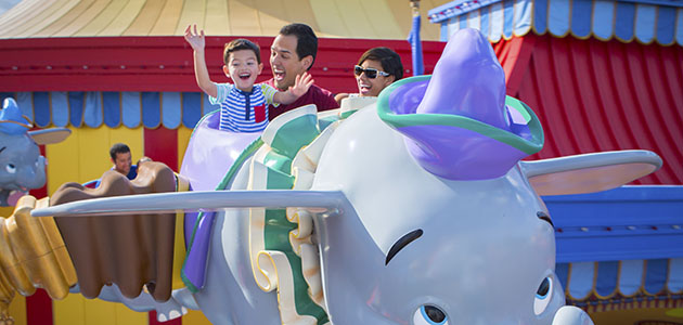 Family enjoying Dumbo the Flying Elephant at Magic Kingdom Park.
