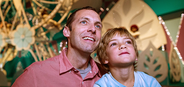 Father and son enjoying 'it's a small world' at Magic Kingdom Park.