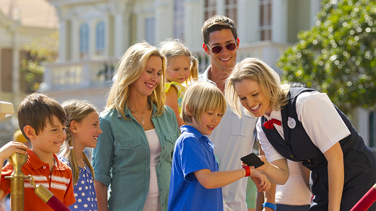 Family using their MagicBand at a touch point to get on an attraction