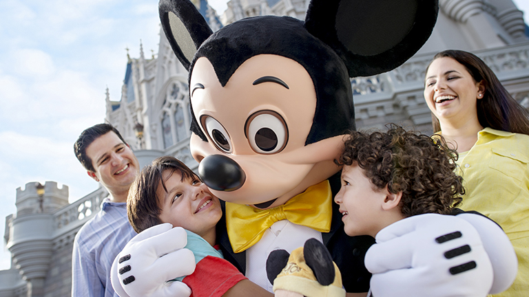 Family with Mickey Mouse at Magic Kingdom
