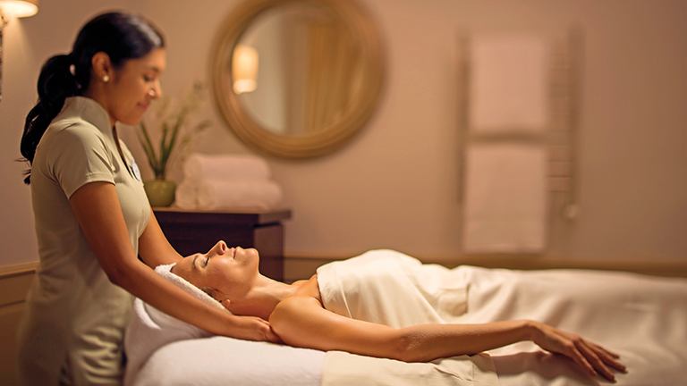 Guest enjoying a massage at Senses in Disney's Grand Floridian Resort and Spa