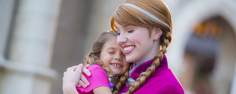 Young guest hugging Anna from Frozen