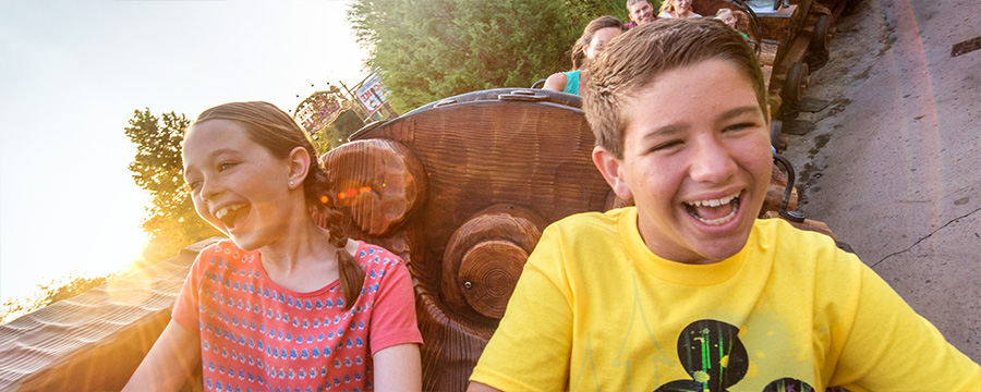 Children riding the Seven Dwarfs Mine Train