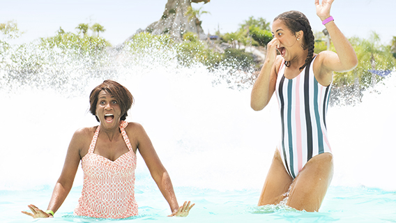 Mother and daughter have fun in Typhoon Lagoon's surf pool
