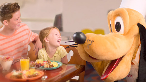 Young guests dine with Pluto at Chef Mickeys