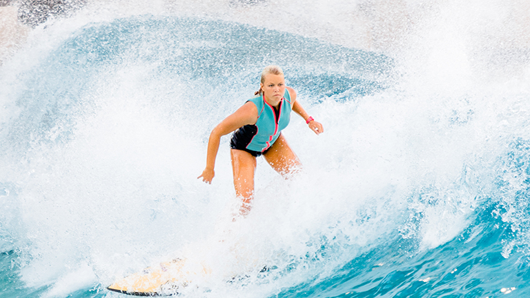 Girl surfing at Typhoon Lagoon