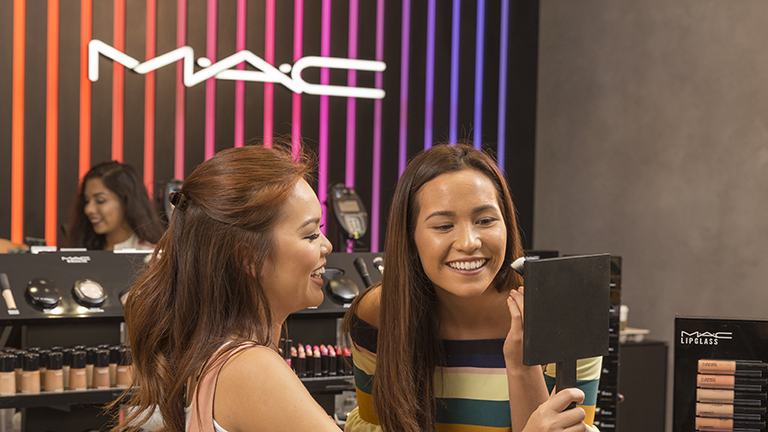 Girls shopping at Mac at Disney Springs