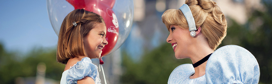 Young guest meeting Cinderella at Disney's Magic Kingdom Theme Park