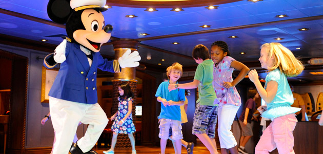 Captain Mickey dancing with young guests in Disney's Oceaneer Club.