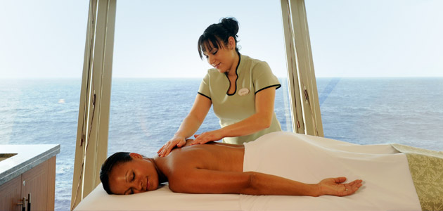 Guest enjoying a massage at the Senses Spa & Salon onboard Disney Dream.