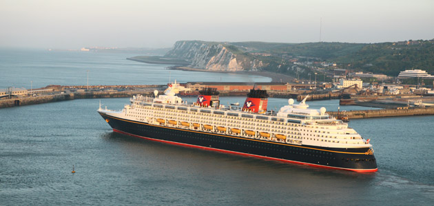 The Disney Magic sailing past the White Cliffs of Dover.