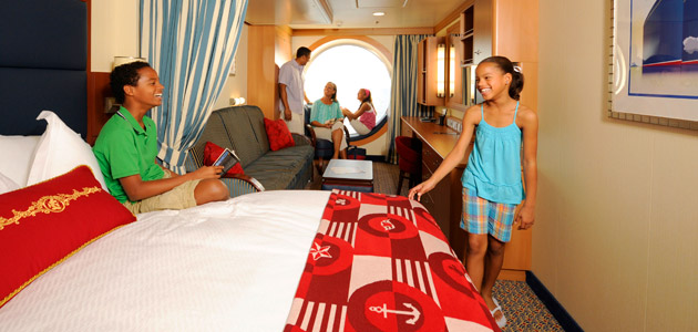 Family in a beautiful Oceanview Stateroom onboard Disney Dream.