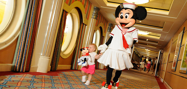 Young guest with Minnie onboard Disney Magic.