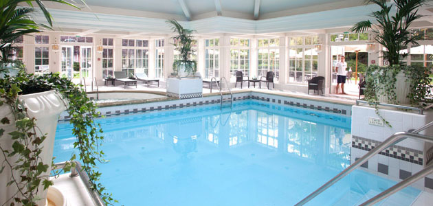 Indoor pool with whirlpool bath, sauna, jacuzzi and steam room