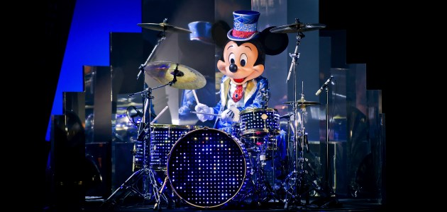 Mickey Mouse playing the drums at Mickey's Christmas Big Band