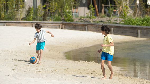 Young guests playing in the sand at Les Villages Nature Paris