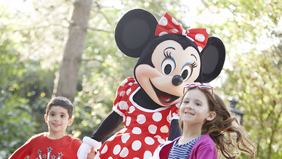 Young guests with Minnie Mouse at Disneyland Paris