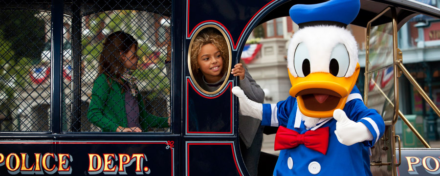 Donald and young Guests on Main Street U.S.A.®
