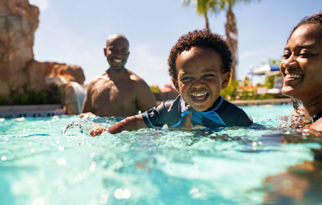 Family in the pool at Disney's Riviera Resort