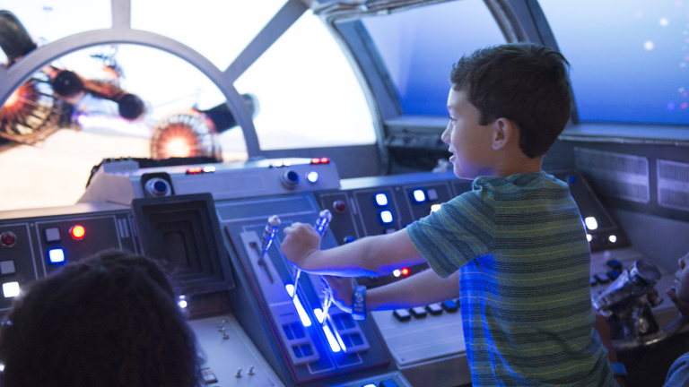 Young guest playing on the Millennium Falcon
