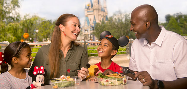 Family enjoying a self-service meal in Magic Kingdom Park