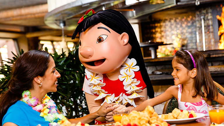 Mother and daughter enjoying a character breakfast at Ohana, joined by Lilo