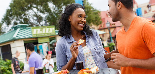 Guests having food at Epcot International Food and Wine Festival
