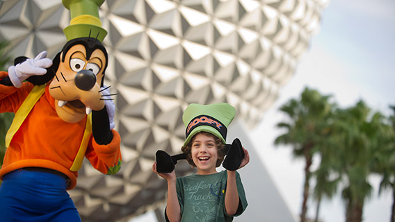 Little boy meets Goofy at Epcot