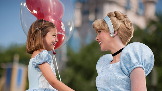 Little girl meets Cinderella at Magic Kingdom