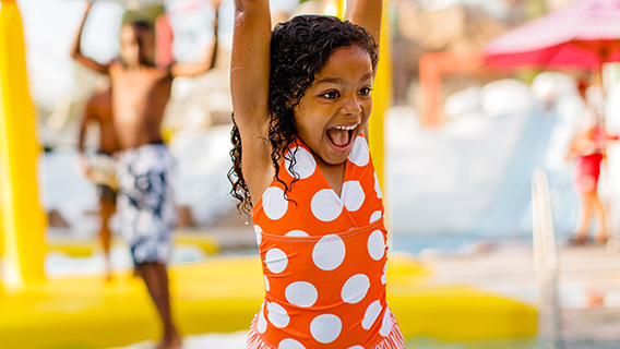 Little girl enjoying the watery fun at Blizzard Beach