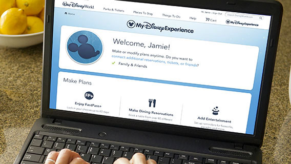 Guest using My Disney Experience on laptop