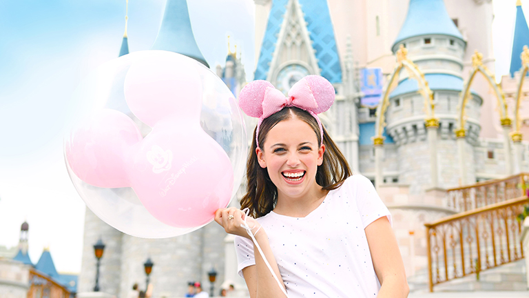 Teenager at Cinderella Castle in Magic Kingdom theme park