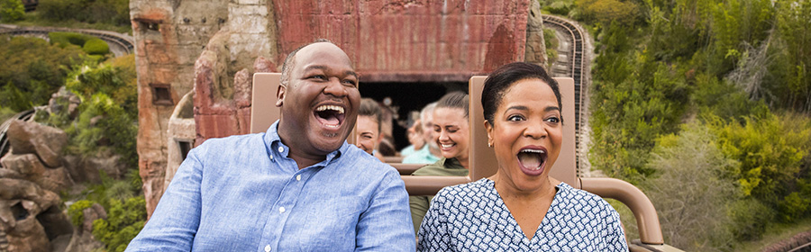 Couple enjoying Expedition Everest at Disney's Animal Kingdom Theme Park
